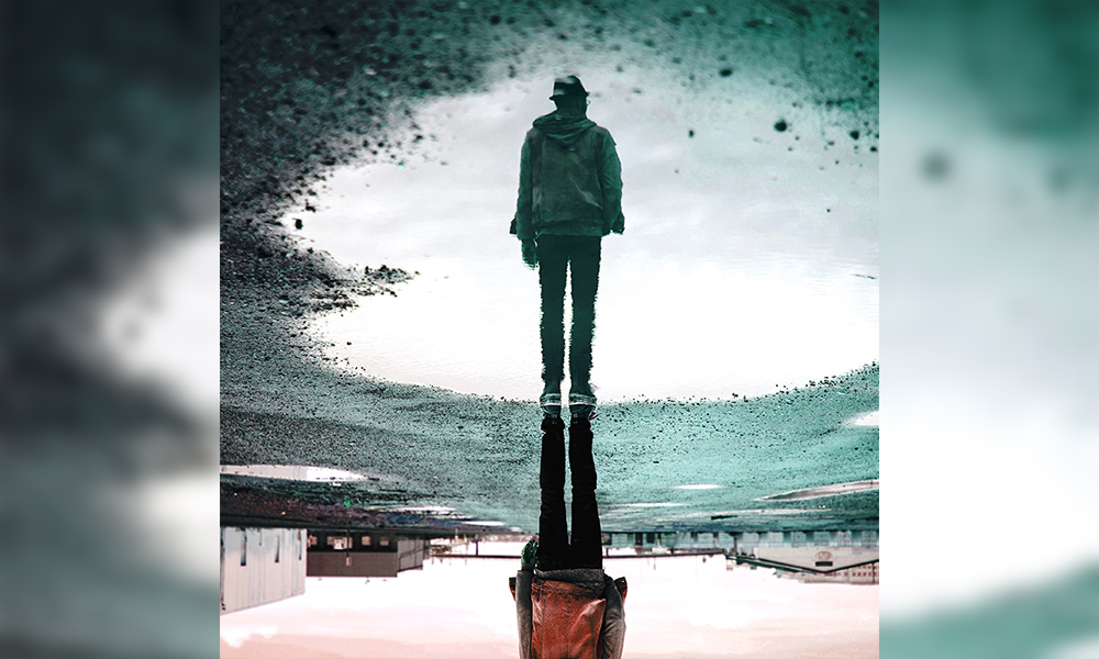 "Image shows man in the reflection for poem ""You Are"" - Poem by We Are The Writers"